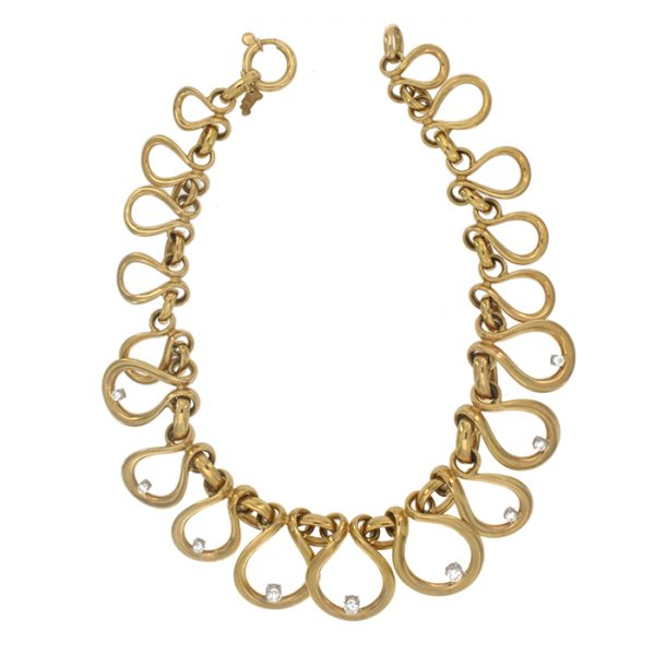 Necklace in yellow gold with white zircons